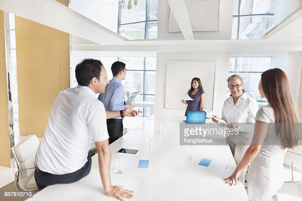 Group planning together in business conference room