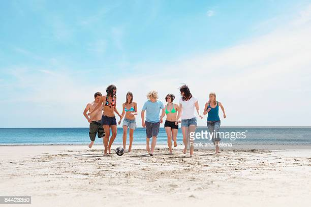 Group playing with ball on beach