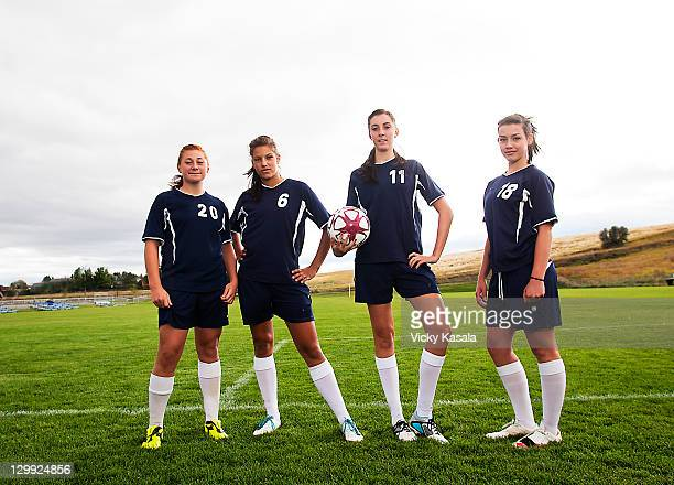 group portait of teen girl soccer players