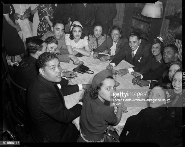 Group portrait around a table at the Loendi Club Pittsburgh Pennsylvania April 1938 Pictured are clockwise from bottom center Thelma Spangler...