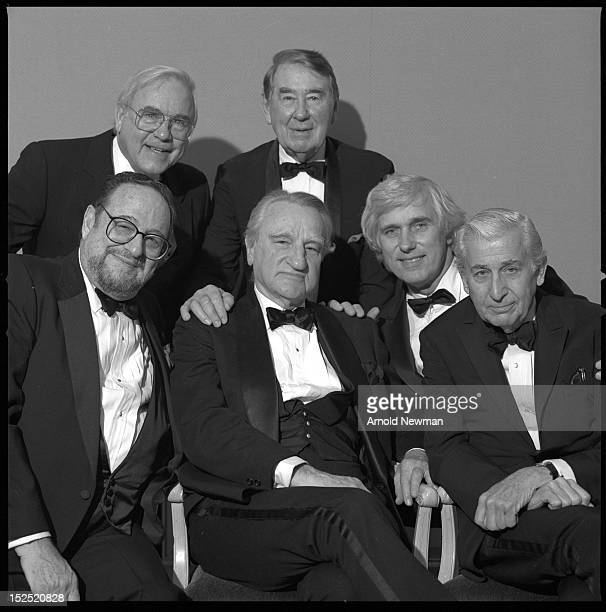 Group portrait at a dinner party for American magazine editor Frank Zachary January 7 1992 Photographer Arnold Newman is seated at front left