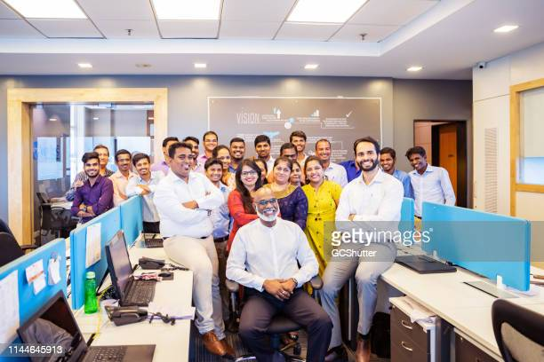 group portrait from a corporate office in india - employee stock pictures, royalty-free photos & images