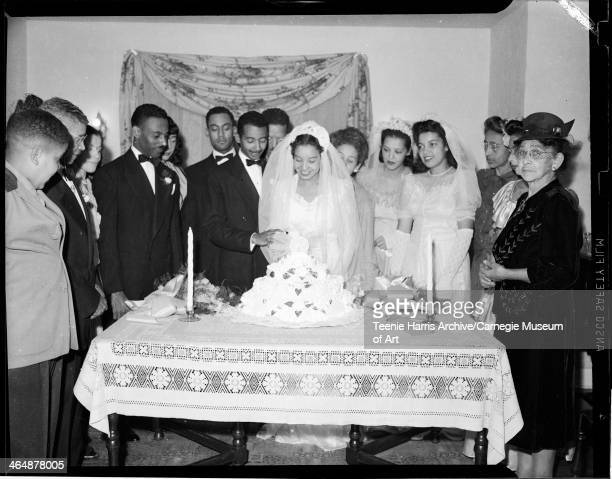 Charles Johnson Tommy Roberts groom Julius Banks and bride Nora Elizabeth Lee Banks cutting four tiered wedding cake Jerry Washington and Eva Ruth...