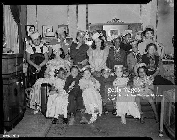 Group portrait gathered for Eileen McPhierson's tenth birthday party in her home at 1418 Wylie Avenue Hill District Pittsburgh Pennsylvania February...