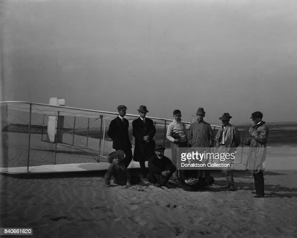 Group portrait in front of glider at Kill Devil Hill Sitting Horace Wright Orville Wright and Alexander Ogilvie standing Lorin Wright and group of...