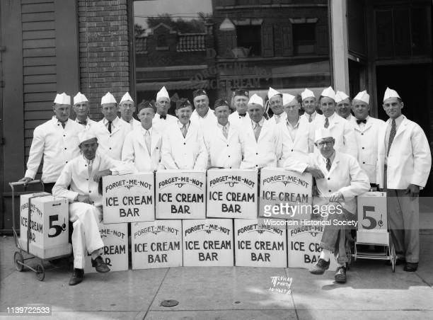 Group portrait of 22 disabled American veterans who are ForgetMeNot ice cream bars vendors Madison Wisconsin May 17 1934 They pose in front of 503...