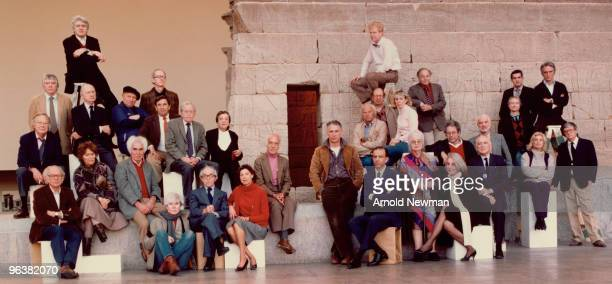 Group portrait of a large group of artists as they pose in front of the Temple of Dendur in the Metropolitan Museum of Art New York New York November...