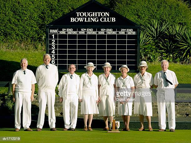 group portrait of a senior bowling team - organised group stock pictures, royalty-free photos & images