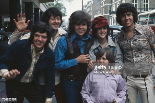 Group portrait of American family vocal group The Osmonds posed outside a hotel in London in 1973 The group are from left to right Jay Osmond Wayne...