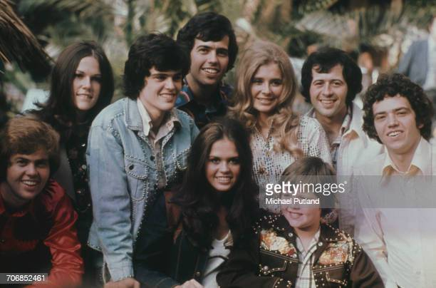 Group portrait of American family vocal group The Osmonds posed with friends in 1973 Group members are from left to right Merrill Osmond unknown...