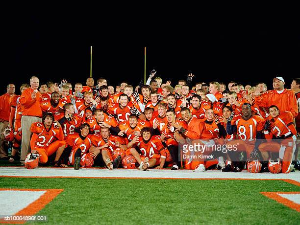 group portrait of american football team in field - american football team stock pictures, royalty-free photos & images