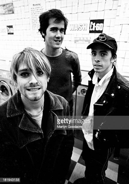 Group portrait of American grunge band Nirvana in Shepherd's Bush London October 1990 LR Kurt Cobain Krist Novoselic and Dave Grohl