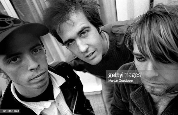 Group portrait of American grunge band Nirvana in Shepherd's Bush, London, October 1990. L-R Dave Grohl, Krist Novoselic and Kurt Cobain.