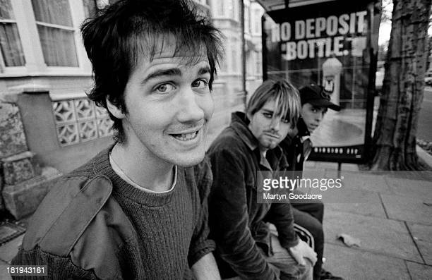 Group portrait of American grunge band Nirvana in Shepherd's Bush, London, October 1990. L-R Krist Novoselic, Kurt Cobain and Dave Grohl.