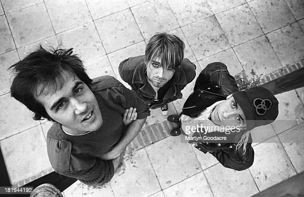 Group portrait of American grunge band Nirvana in Shepherd's Bush London October 1990 LR Krist Novoselic Kurt Cobain and Dave Grohl