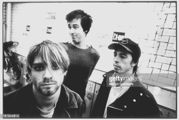 Group portrait of American grunge band Nirvana in Shepherd's Bush, London, October 1990. L-R Kurt Cobain, Krist Novoselic and Dave Grohl.