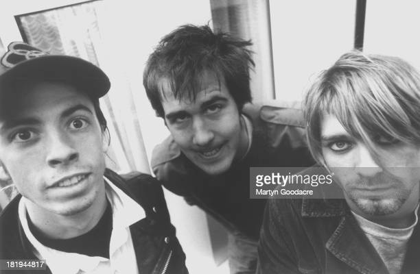 Group portrait of American grunge band Nirvana in Shepherd's Bush London October 1990 LR Dave Grohl Krist Novoselic and Kurt Cobain