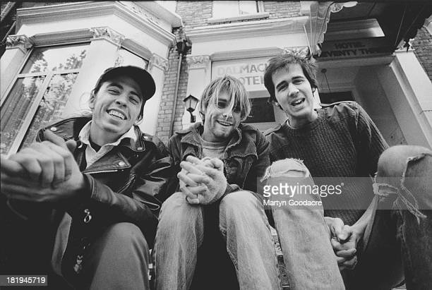 Group portrait of American grunge band Nirvana in Shepherd's Bush London October 1990 LR Dave Grohl Kurt Cobain and Krist Novoselic