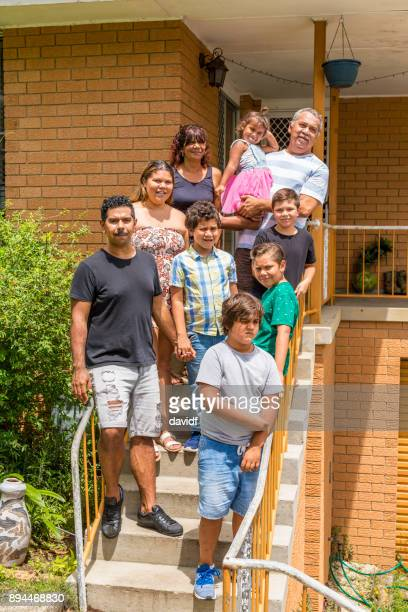 Group Portrait of an Extended Australian Aboriginal Family Outside a Home