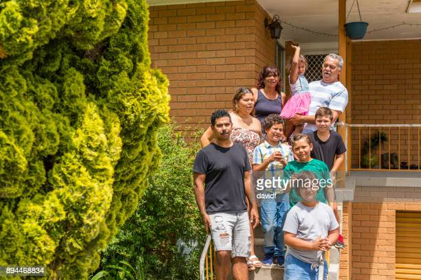 group portrait of an extended australian aboriginal family outside a home - medium group of people stock pictures, royalty-free photos & images