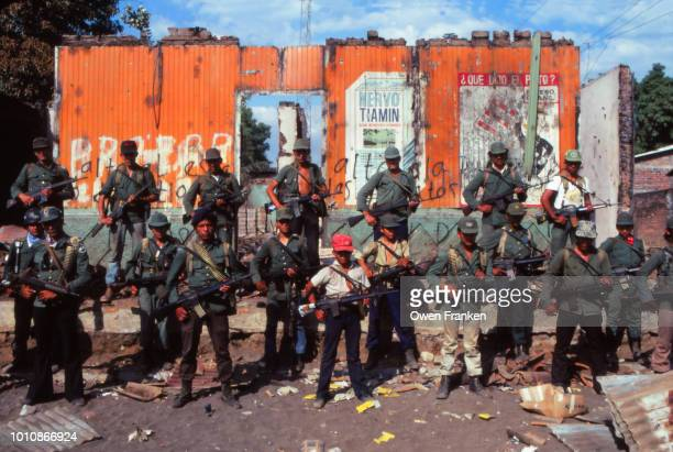 group portrait of anti-government fnsl rebels in el salvador, after having taken a village, 1982 - guerrilla warfare stock pictures, royalty-free photos & images