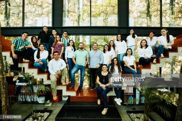 group portrait of architects in design studio - grupo grande de pessoas - fotografias e filmes do acervo