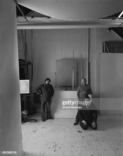 Group portrait of British photographers from left David Bailey Brian Duffy and Terence Donovan as they pose together at Swiss Cottage London England...