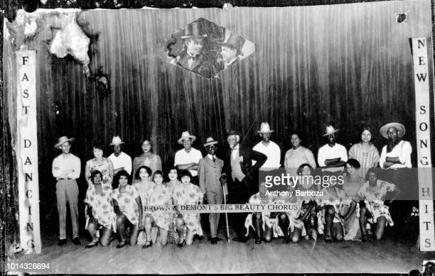 Group portrait of Brown DeMont's Big Beauty Chorus as they poses on stage Harlem New York early twentieth century