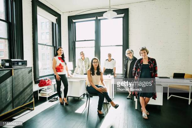 group portrait of businesswomen in creative office - alleen vrouwen stockfoto's en -beelden