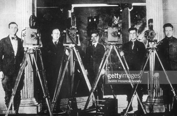 Group portrait of cameramen standing with movie cameras on the set of the silent film 'Patria'