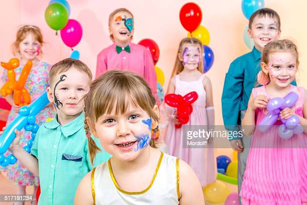 Group Portrait of Cheerful Kids at Children's Party
