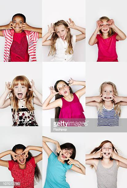 group portrait of children pulling funny faces - only girls stock pictures, royalty-free photos & images