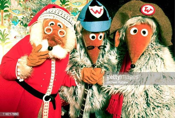 Group portrait of childrens' TV show spin-off band The Wombles, opening christmas presents, London, circa 1974, Left to right: Great Uncle Bulgaria,...