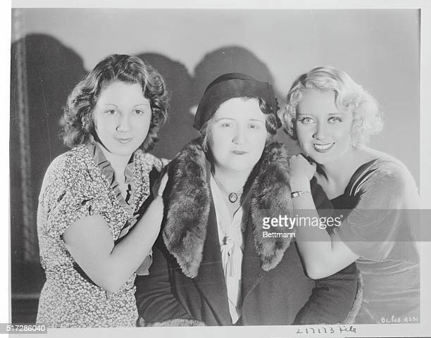 A group portrait of comic actress Joan Blondell who was a popular star of the First National film studio with her sister Gloria and her mother