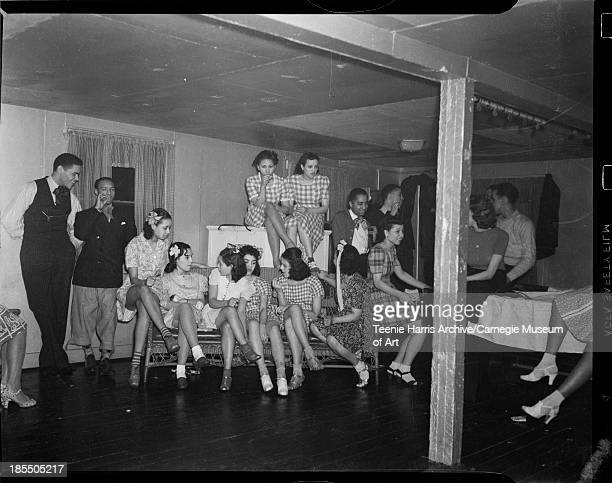 Group portrait of Debs About Town members in home or boxing gym of William 'Woogie' Harris Frankstown Road Penn Hills Pittsburgh Pennsylvania March...