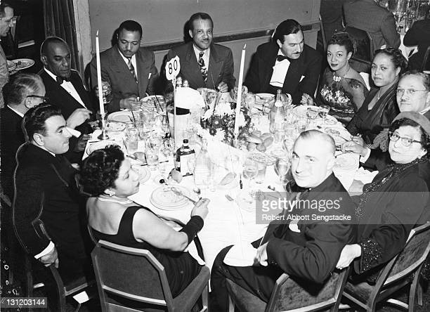 Group portrait of diners at 'Table 80' during an uspecified event 1950 Among those pictured are American newspaper publisher John H Sengstacke lawyer...