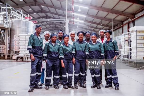 group portrait of factory workers - africa - labor union stock photos and pictures