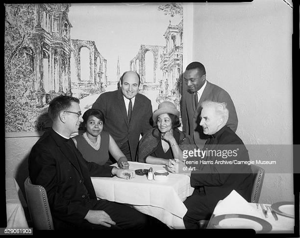 Group portrait of Father Michael Williams Phyliss Garland George Wein Hazel Garland Walt Harper and 'jazz priest' Father Norman J O'Connor posed...