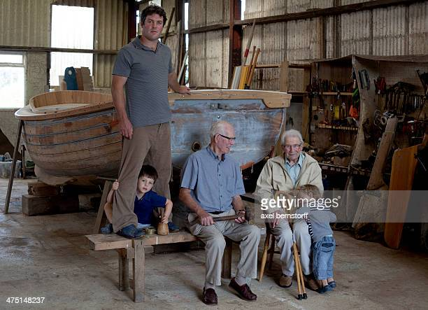 Group portrait of four generations of male boat builders