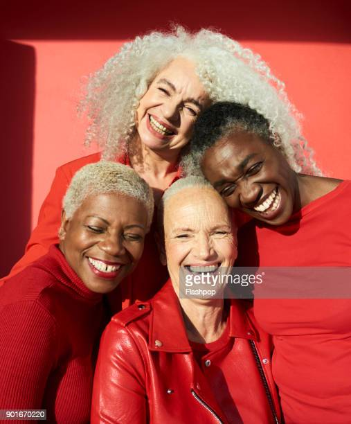 group portrait of four women - western europe stock pictures, royalty-free photos & images