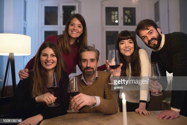 group portrait of friends with wine glasses at table - mid adult women stock pictures, royalty-free photos & images
