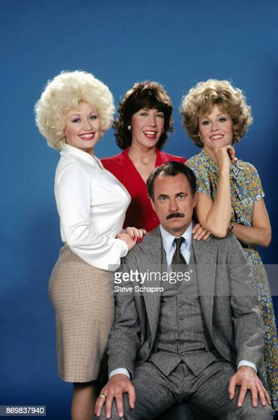 Group portrait of from left American actors Dolly Parton Lily Tomlin Dabney Coleman and Jane Fonda as they pose on the set of the film '9 to 5'...