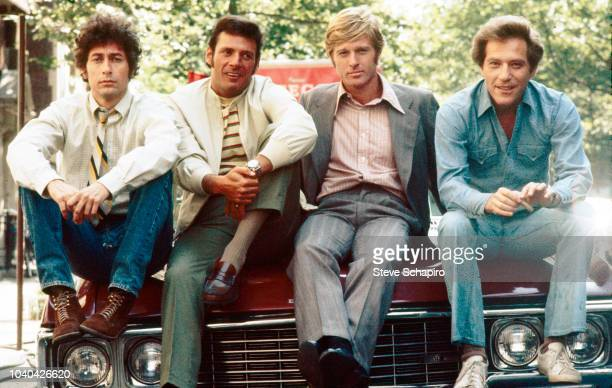 Group portrait of, from left, American actors Paul Sand, Ron Leibman, Robert Redford, and George Segal on the set of the film 'The Hot Rock' , New...