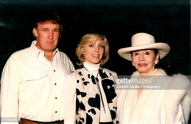 Group portrait of from left American businessman Donald Trump his wife Marla Maples and Peruvian former actress Pilar Pallete as they pose together...