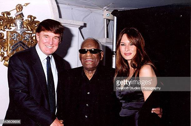 Group portrait of from left American businessman Donald Trump musician Ray Charles Trump's future wife model Melania Knauss as they pose together at...
