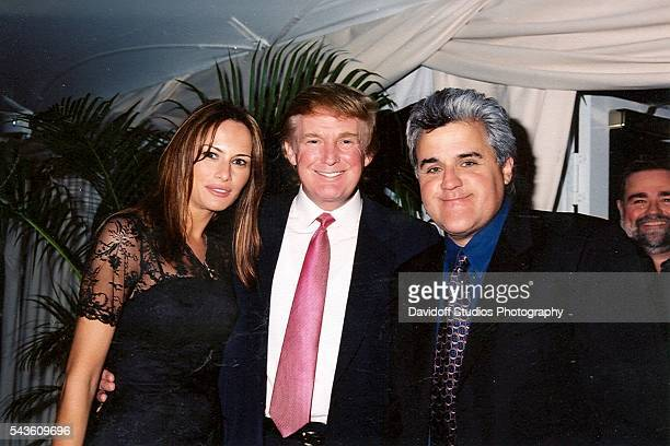 Group portrait of from left model Melania Knauss her future husband businessman Donald Trump and comedian and television host Jay Leno as they pose...