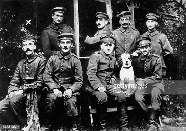 Group portrait of German soldiers from Wold War One which includes future dictator Adolf Hitler [left]. | Location: outdoors.