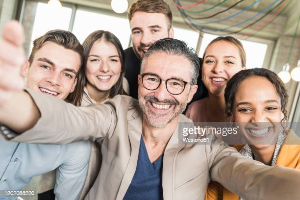 group portrait of happy business people in office - organised group photo stock pictures, royalty-free photos & images