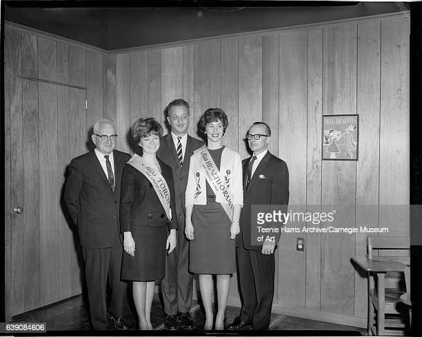 Group portrait of Health-O-Rama Steering Committee members Dr Earl A. Dimmick, 'Miss Torch' Linda Richards, unknown man wearing striped necktie,...