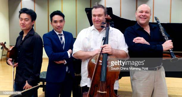 Group portrait of HK Phil musicians Concertmaster Jing Wang pianist Warren Lee Richard Bamping and Andrew Simon who are joining forces for a May...